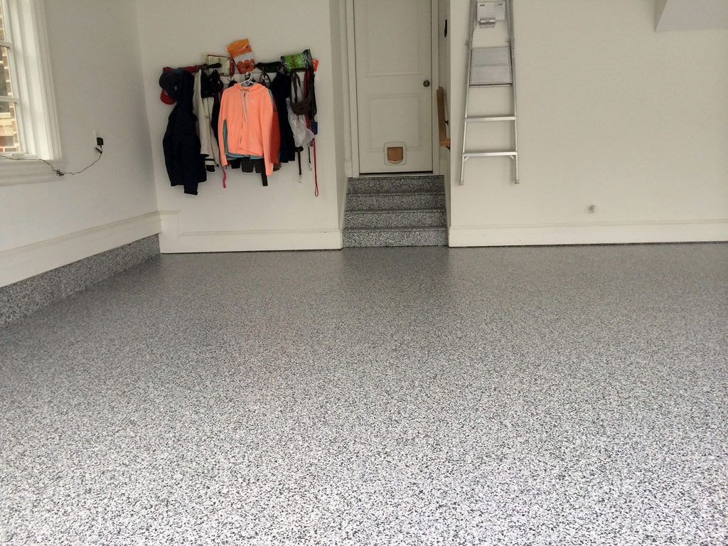 Epoxy coatings by Stronghold Floors added functionality and style to this garage.